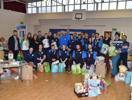 The Brick are helped by Latics to Pack Christmas Hampers